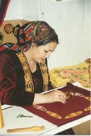 Muslim lady sewing embroidery
